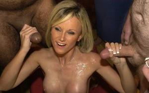 Blonde slut Barbie Style gets plastered in sperm during a bukkake party