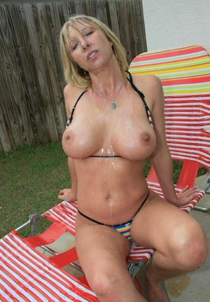 Big busted Mummy gives a great tugjob and gets bukkaked outdoor