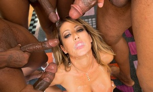 Dirty light-haired MILF Capri Cavanni collects a group of ebony men for a gangbang