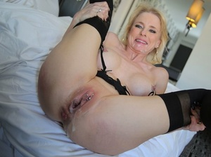 Horny cougar Cammille with shaved pussy gets creampied after being gangbanged