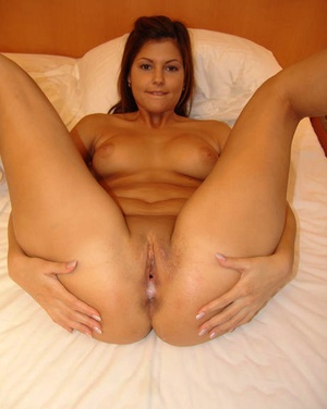 Naked ex girlfriend sports a creampie pussy with her legs spread on bed