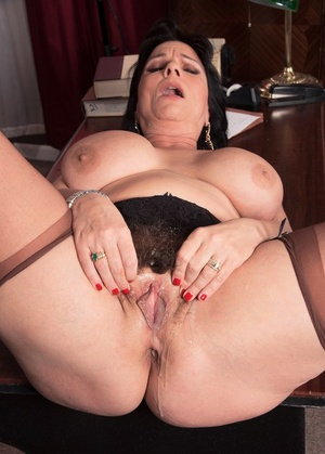 Big boobed mature lady bangs a younger man in her judge's chambers