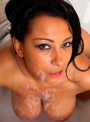 Naked mature girl Danica Collins shows her titties and twat while bathing