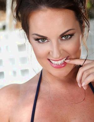 Chesty European centerfold model Sarah Nicola Randall posing in bikini