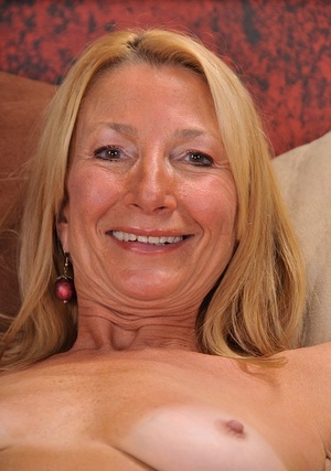 Older lady Pam Roberts dropping yellow underwear and spreading pussy