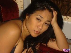 Chubby Asian girl with black hair poses non nude in a black bikini