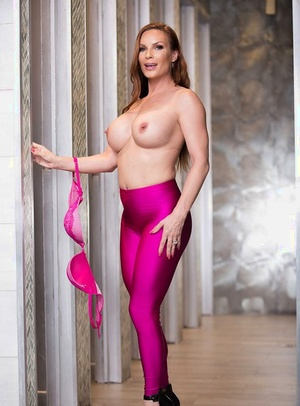 Redhead housewife Diamond Foxxx baring big tits in yoga trousers for babe pics