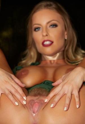Beautiful blonde Britney Amber crosses her nude gams before stretching her twat