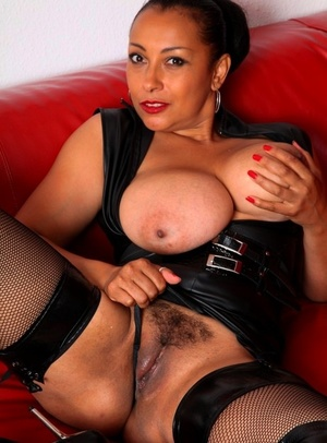Busty mature woman Danica Collins fingers her fuckbox in OTK boots