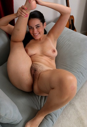 Smiley brown-haired Nyla Parker unclothing slowly to suck on her sexy toes naked