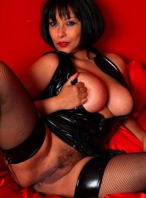 Super hot older lady Danica Collins masturbates in mesh stockings and spandex attire