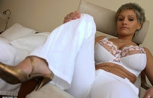Short haired female Bella Donna fills out her sexy bra in bell bottom pants