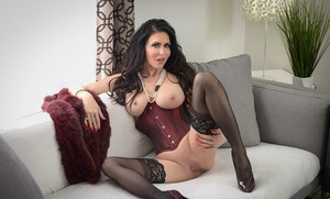 Brown-haired pornstar Jessica Jaymes eats a dick after sex in corset and hoisery