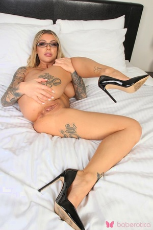 Tattooed model Karma Rx showcases her pussy with manicured fingernails