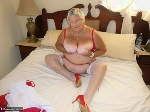 Fat old woman Grandma Libby bares her tan lined breasts and twat on her bed