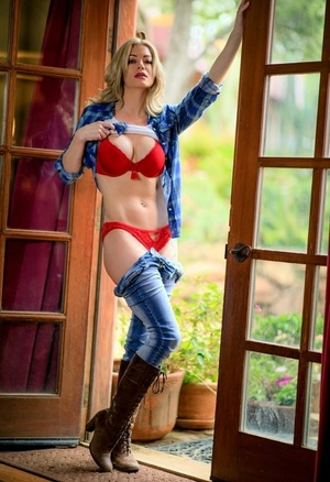 Spectacular blonde releases her hot ass from panties and jeans in calf high shoes