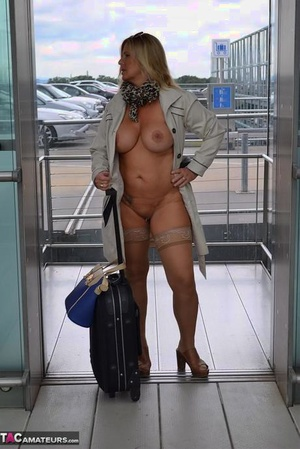 Kinky big tit mature exhibitionist wears nothing underneath coat in public