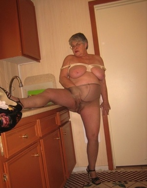 Old woman Girdle Goddess strips to tights in her kitchen