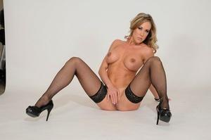 Busty mature woman Brandi Love goes p2m in black stockings