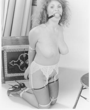 Attractive big boobed MILF in tights got bound in kinky vintage BDSM scene