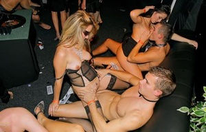Hot chicks have sex with other hot chicks and men inside a swing club