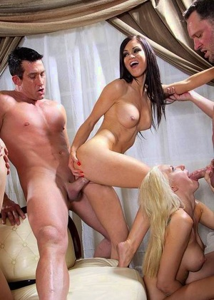 Nude adult movie stars go wild during gangbang on a white leather sofa