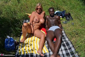 Busty blonde super-bitch Chrissy has her pierced pussy exposed on interracial picnic