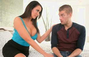 Big titted MILF Reagan Foxx sucks off a hard shaft after riding on top of it