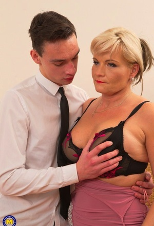 Sexy mature lady with blonde hair hooks up with her toy man during her travels
