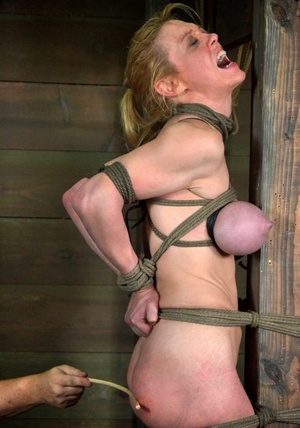 Busty chick victim Darling got tied up and tortured by a dominant couple