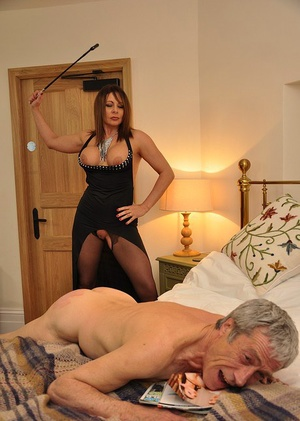Mistress Carly beats her male slave's ass with crop and makes him eat her out