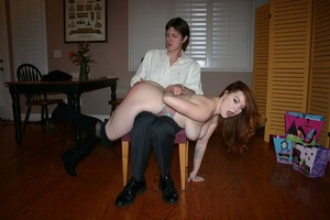 Naked female Summer Hart has her culo turned red during bare hand spanking