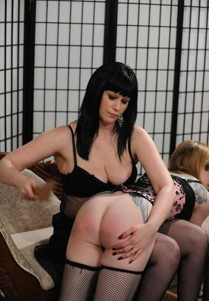 Lady lovers spank each other and have sex with a strapon cock