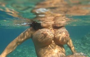 Big boobed lesbians Aneta Buena and Kora Kryk go for a topless swim