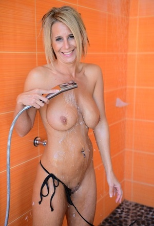 Water jet satisfies fascinating MILF with big tits in the cozy shower stall