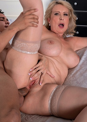 Mature blonde lady Laura Layne gets penetrated in the ass by a Latino gigolo