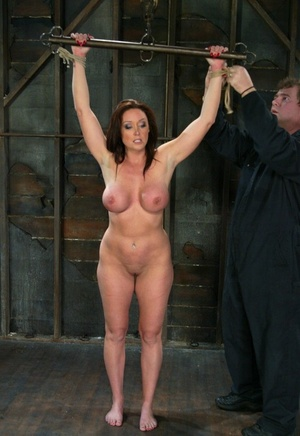 Plump damsel Christina Carter feels the weight of nipple clamps on her big tits