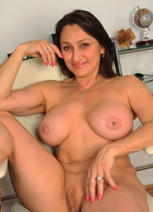 Busty middle-aged lady Jillian Foxxx toys her soaking wet pussy to completion