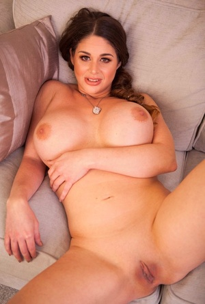 Big tit MILF Cathy Heaven displays her cock thirsty twat on the sofa