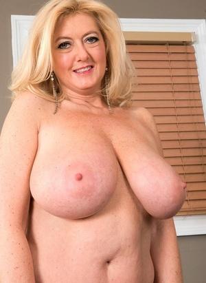Big boobed granny Tahnee Taylor sucks off her young lover's big dick