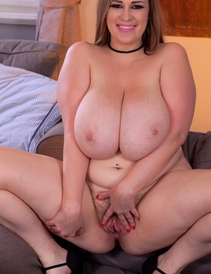 BBW Smiley Emma covers her massive boobs with milk after disrobing