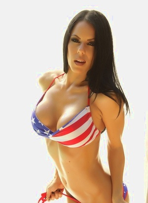 Dark haired female Jennifer fills out a USA themed bikini in solo action