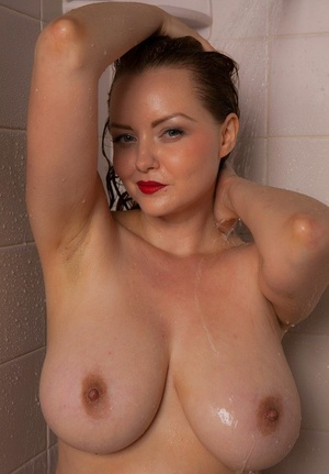 Big-boobed mature fatty Natasha Dedov wearing a wet white t-shirt in the shower