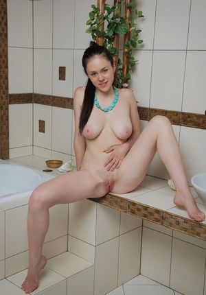 Young and busty girl Annis A showcases her smooth beaver in the bathroom