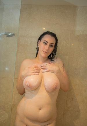 Chubby housewife Chloe Jenks showering her massive breasts