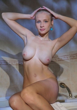 Busty model Penelope G wets her hard nipples & clean-shaven beaver in the shower