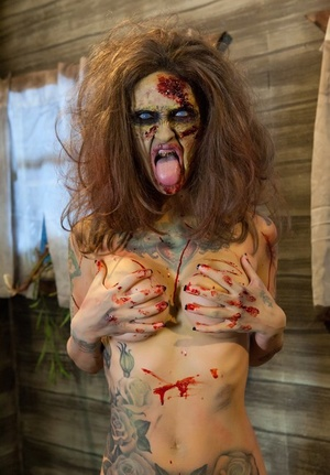 Saucy brunette cosplayer Kleio unveils her zombie tits and beaver
