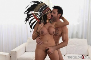 Mature woman in Native American attire has her big knockers and snatch fondled