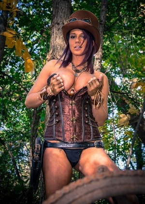 Amateur cosplay girl Nikki Sims in g-string baring her rigid boobs in the forest